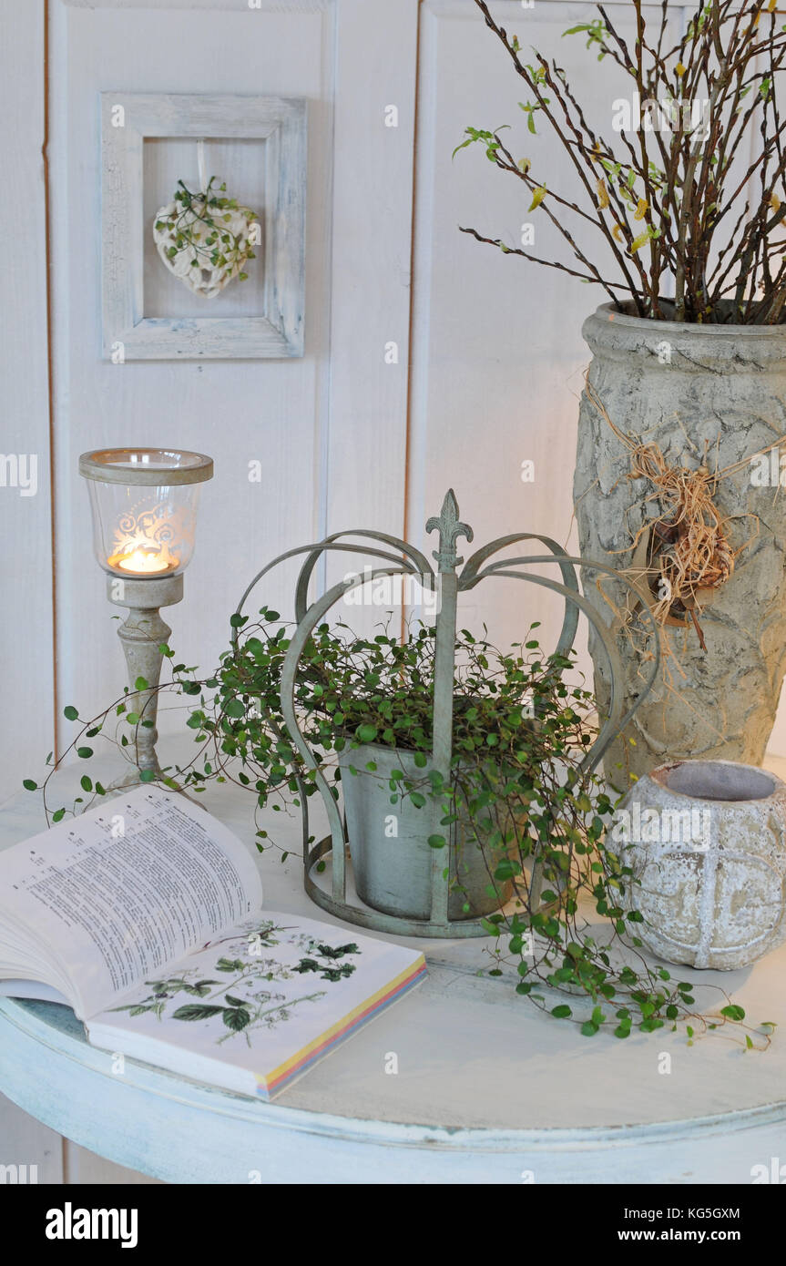 Stilllife with candle and plants, vintage - Stock Image