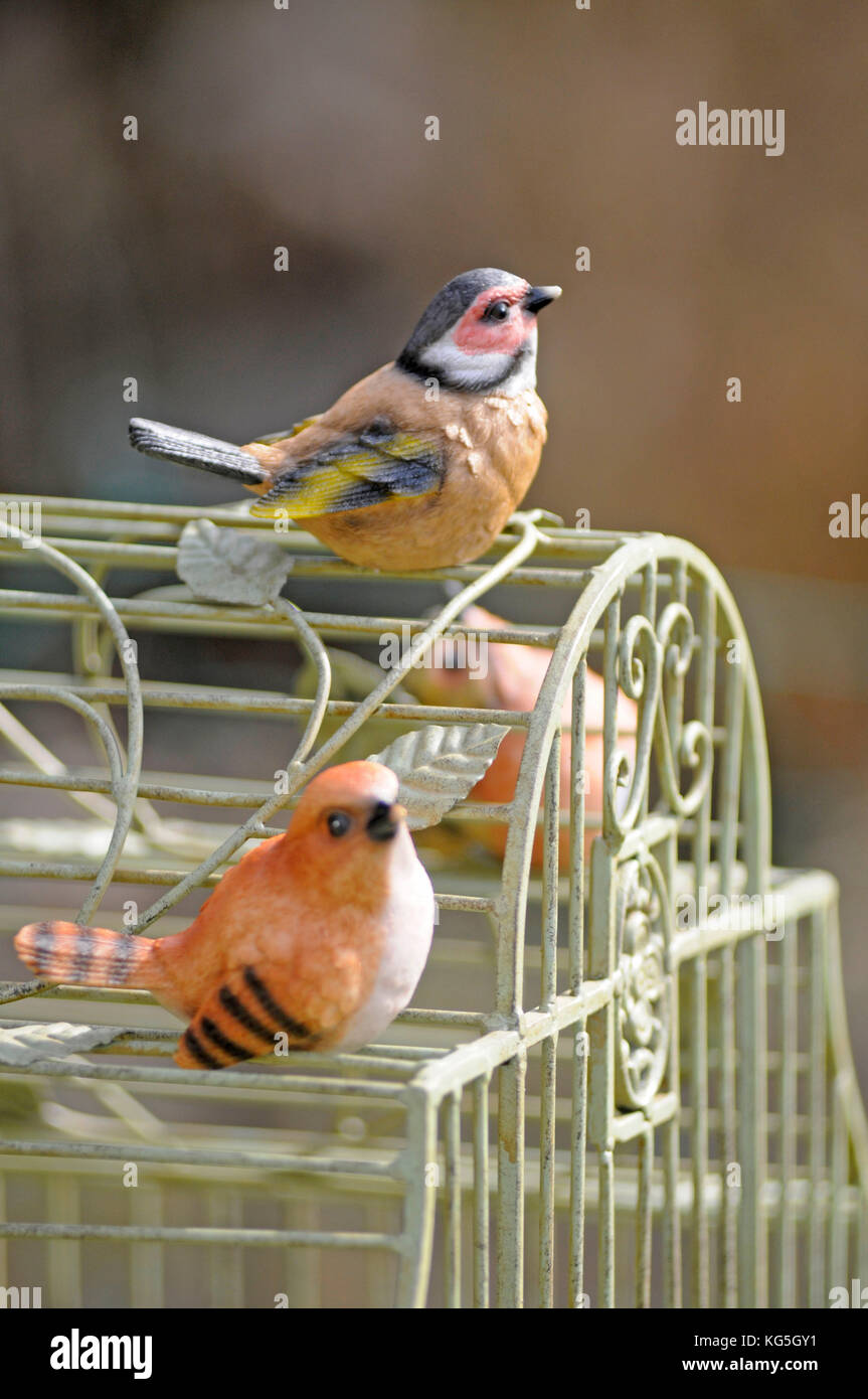 decoration birds on metal cage, close-up - Stock Image