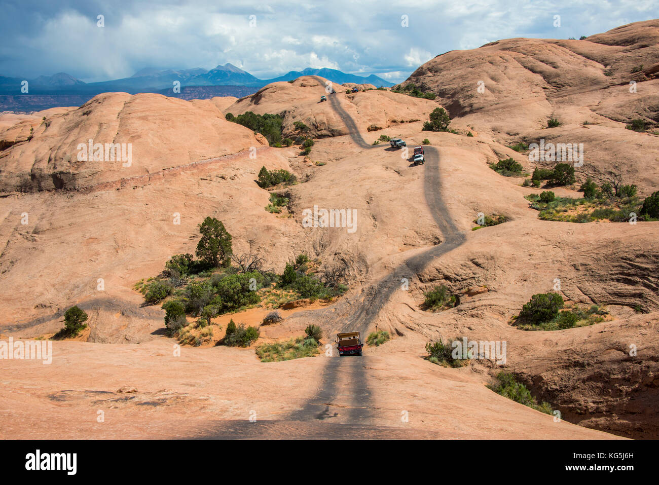 Hummer driving on the slickrock trail, Moab, Utah, USA - Stock Image