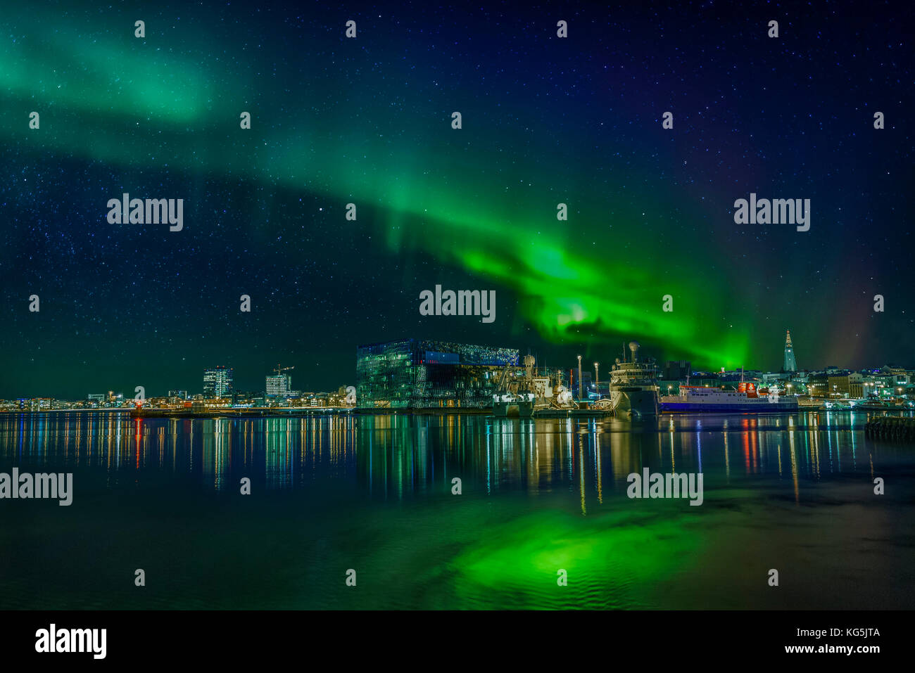 Northern lights shinning bright over Reykajvik, Iceland - Stock Image