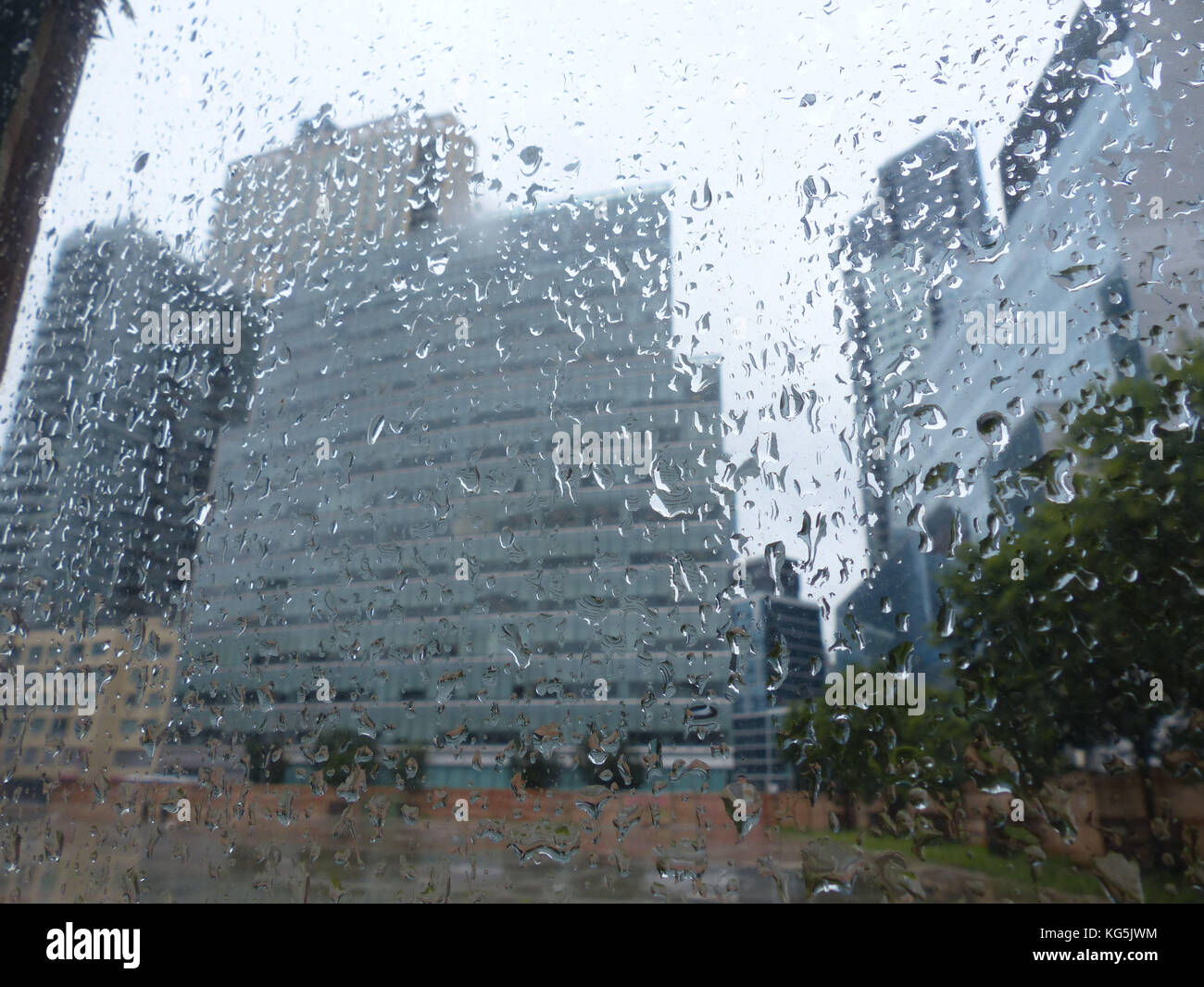 Queens, New York, new office buildings in Long Island City photographed through rained on glass - Stock Image