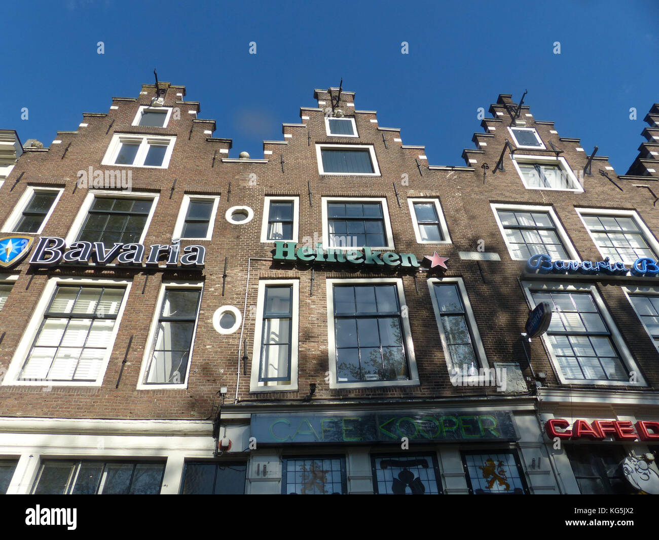 Amsterdam townhouses with beer ads - Stock Image