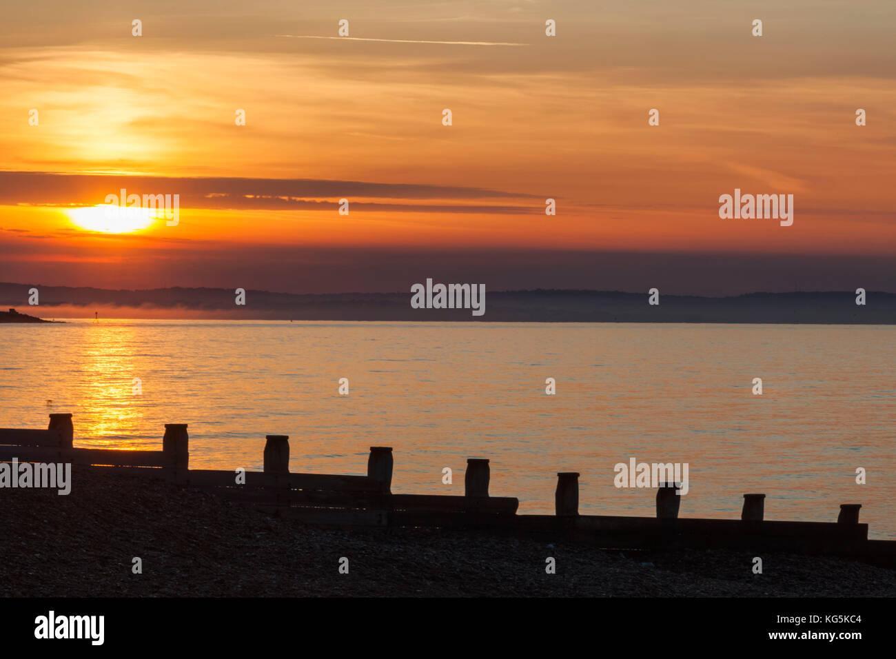 England, East Sussex, Eastbourne, Sunrise over Eastbourne Beach - Stock Image