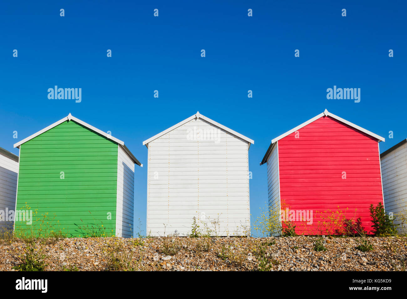 England, East Sussex, Eastbourne, Eastbourne Beach, Colourful Beach Huts - Stock Image