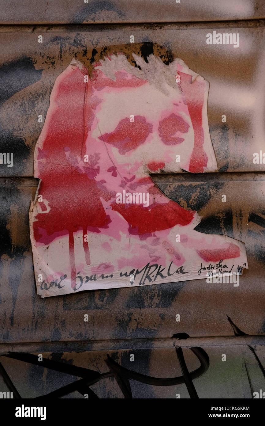 Europe, Czech Republic, Olomouc, Olmütz, wall, poster, graffity, female face - Stock Image