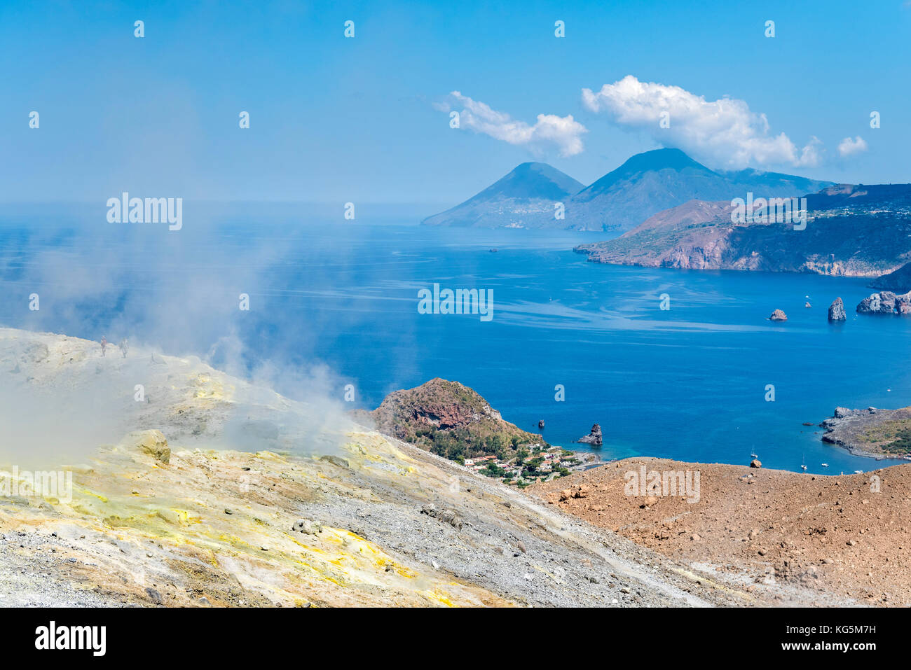 Volcano, Messina district, Sicily, Italy, Europe. Sulfur fumaroles on the crater rim of Vulcano. In the background - Stock Image