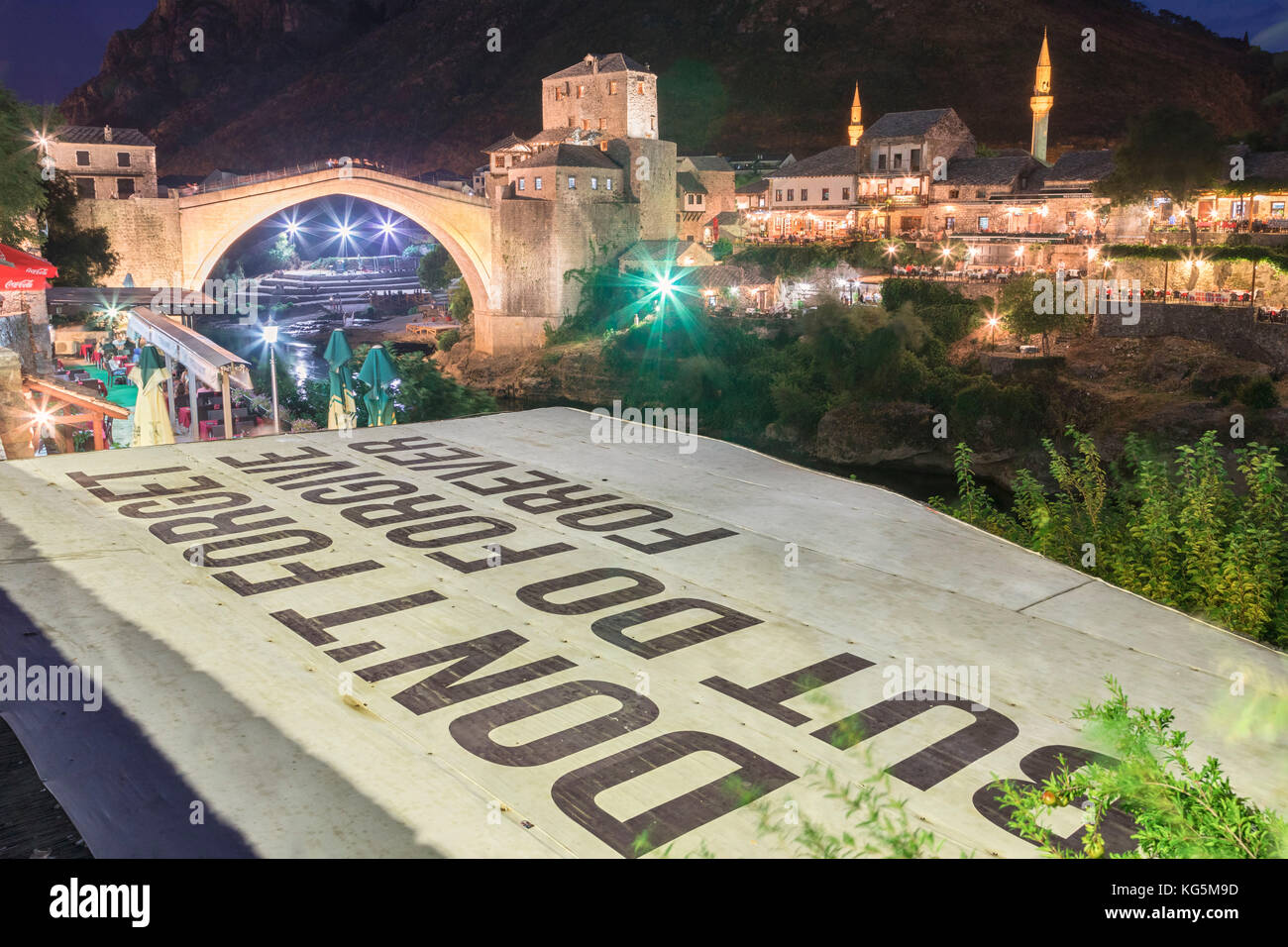 Old Bridge (Stari Most) and and a sentence Don't forget but do forgive, referring to the war in the Balkans, - Stock Image