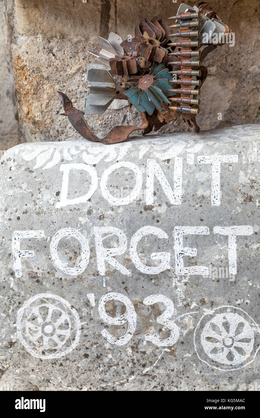 A rock inscribed with Don't Forget '93 referring to the war on the Onescukova street, Mostar old town, Bosnia - Stock Image