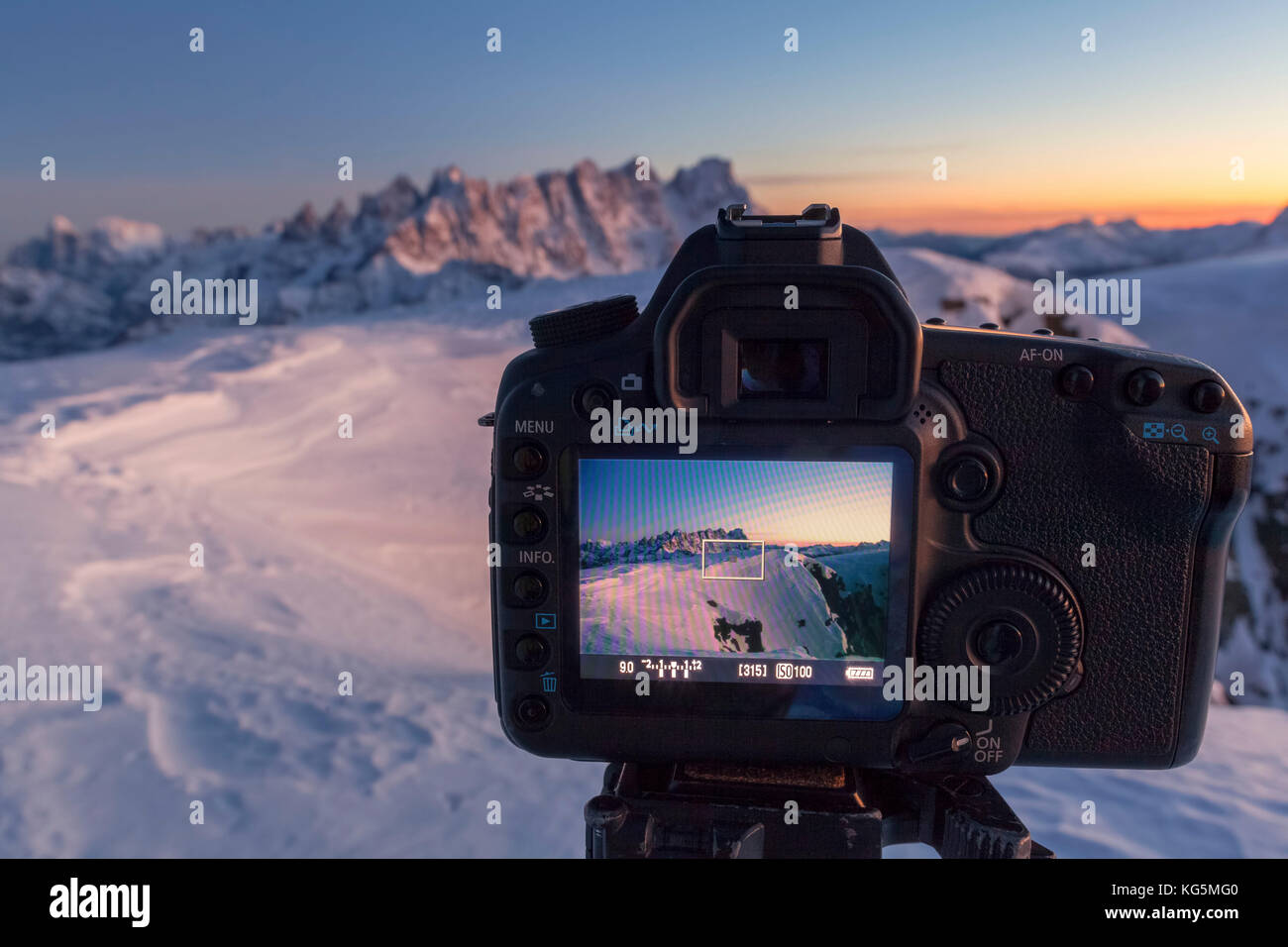 Europe, Italy, Veneto, Belluno. A SLR camera in mountain with live view display active frames the mountains in background - Stock Image