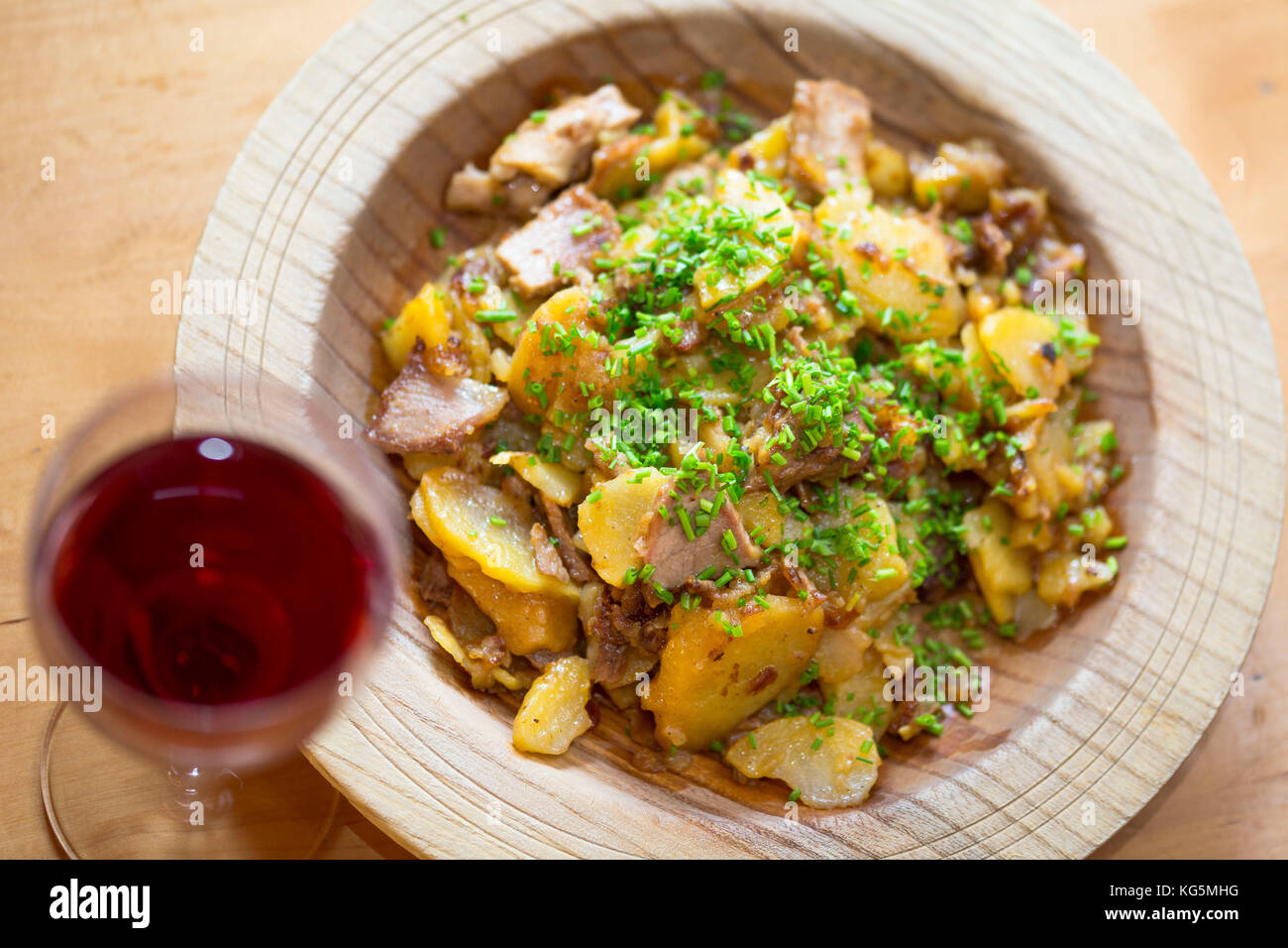 a plate of gröstl, a typical tyrolean food with meat, onions, chives and potatoes, Bolzano province, South - Stock Image