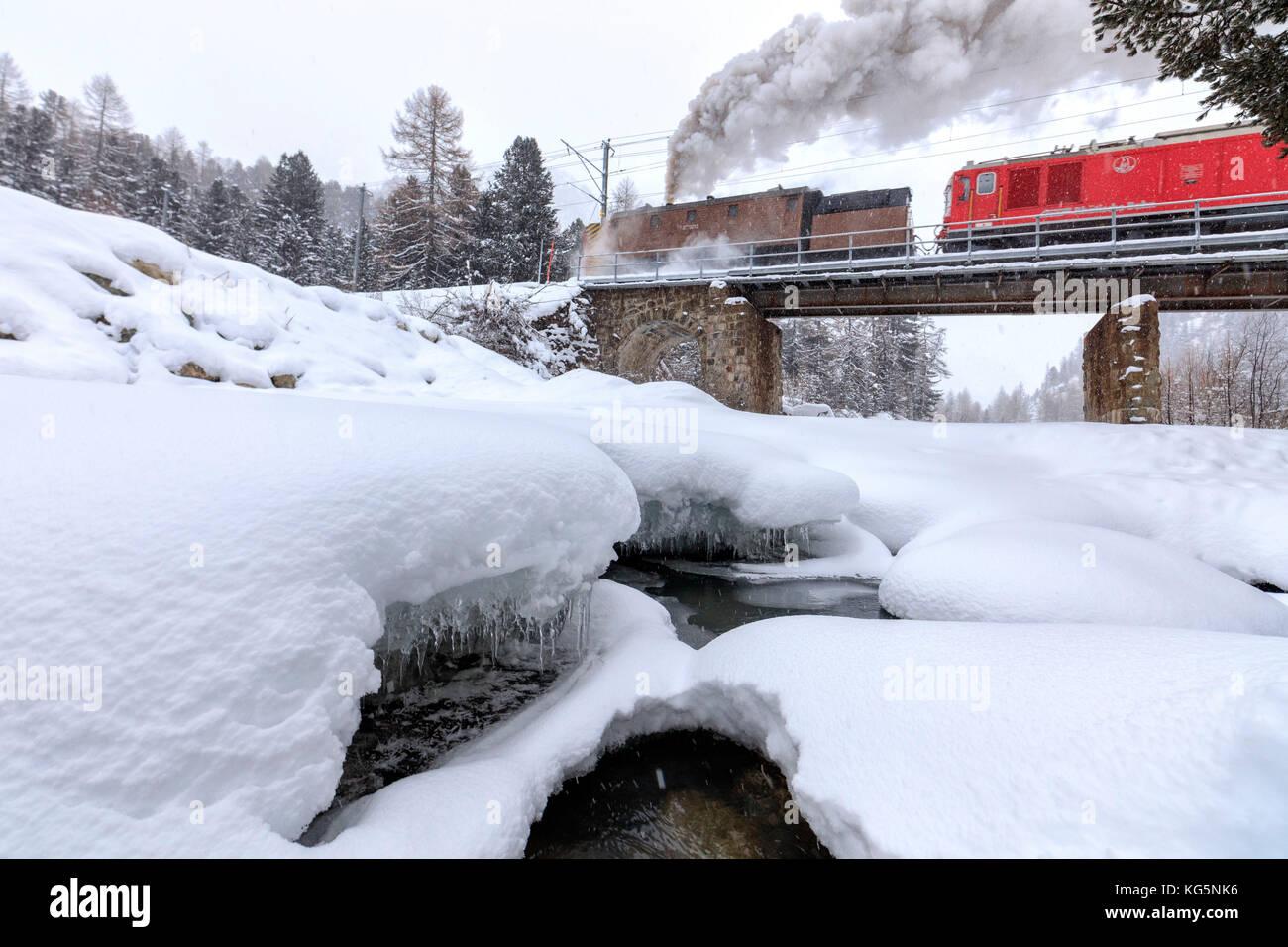 Steam of the snowplow of the Bernina Express train, Morteratsch, canton of Graubünden, Engadin Valley, Switzerland - Stock Image