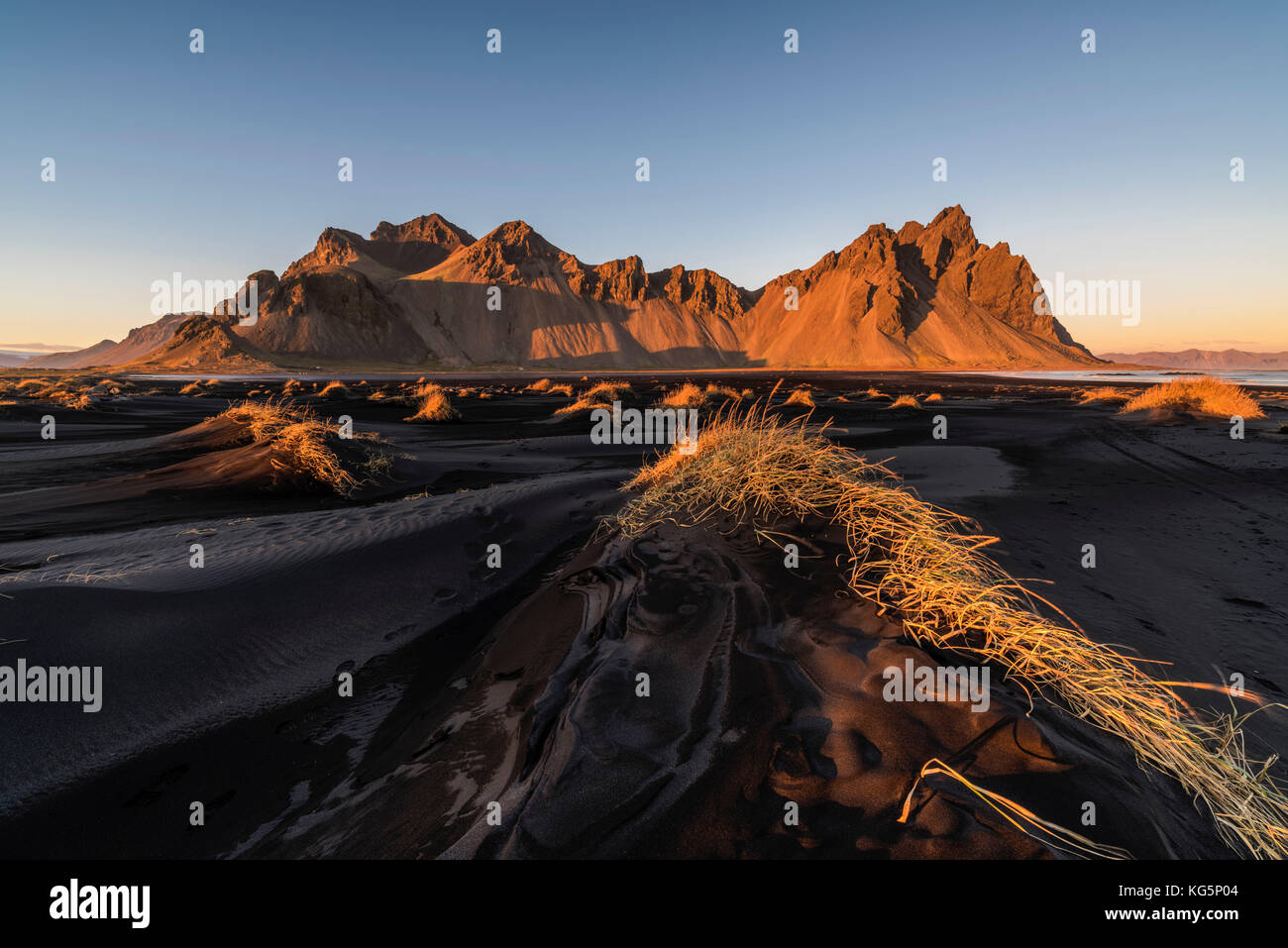 Stokksnes, Hofn, Eastern Iceland, Iceland. Vestrahorn mountain and the black sand dunes at sunset. Stock Photo
