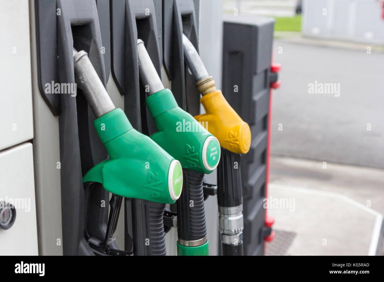 Gas filling nozzles (guns) at a gas station. Stock Photo