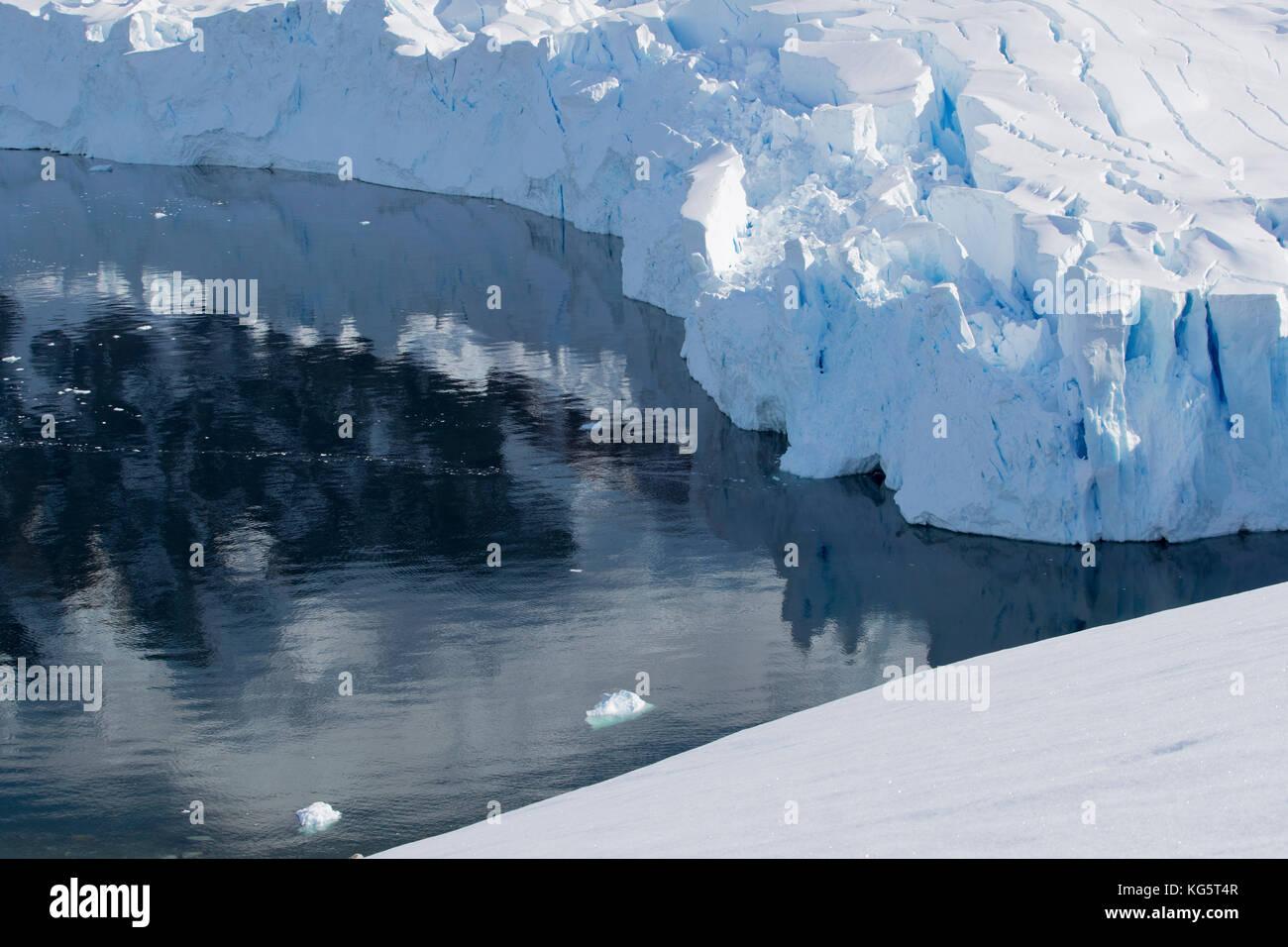 Glacier and water reflections, Antarctic Peninsular - Stock Image