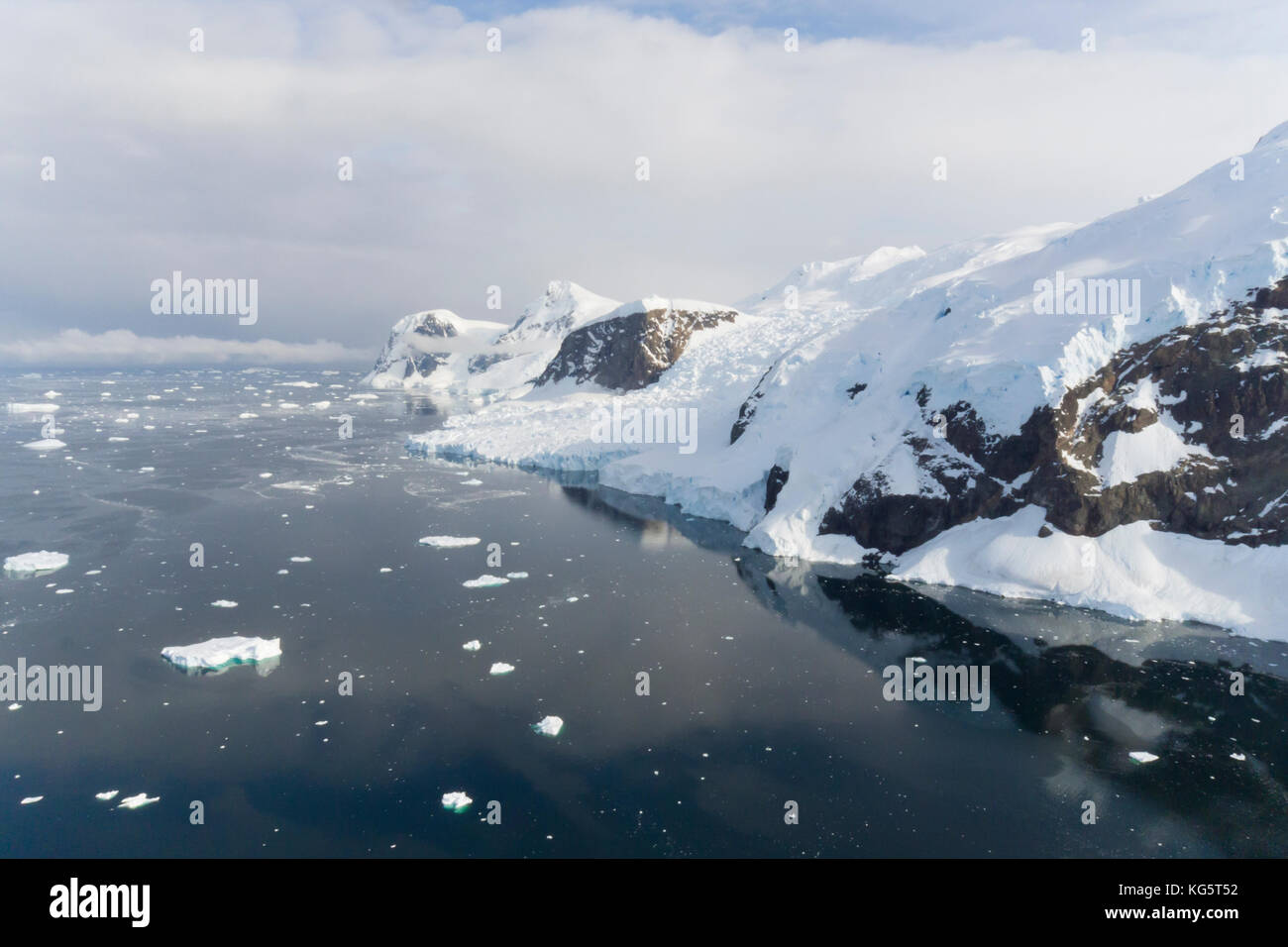 Aerial of mountains and water, Neko Harbor, Antarctica. - Stock Image