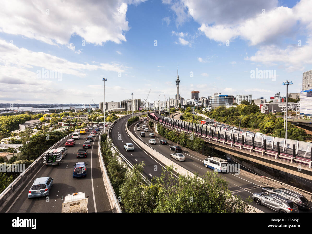 Heavy traffic along the spaghetti junction of various highways in Auckland, New Zealand largest city on a sunny - Stock Image