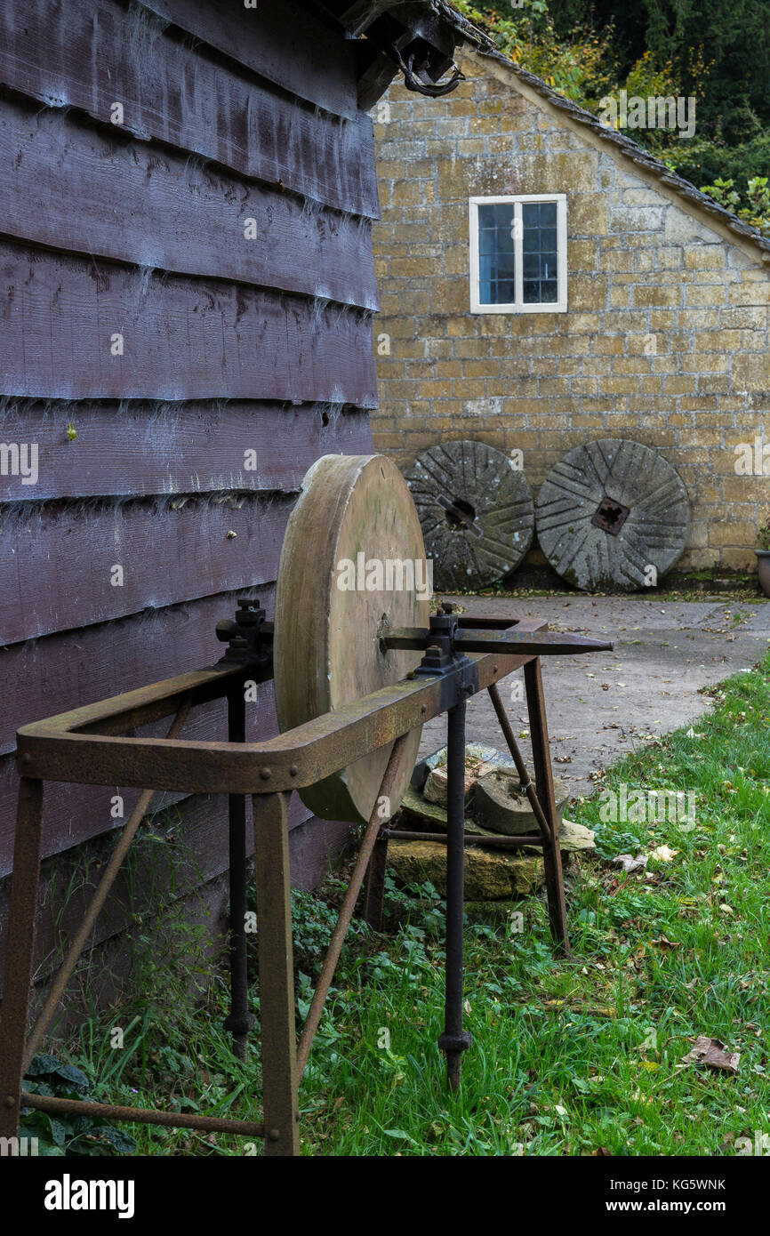 Grinding stone at Stanway Mill, Gloucestershire Stock Photo