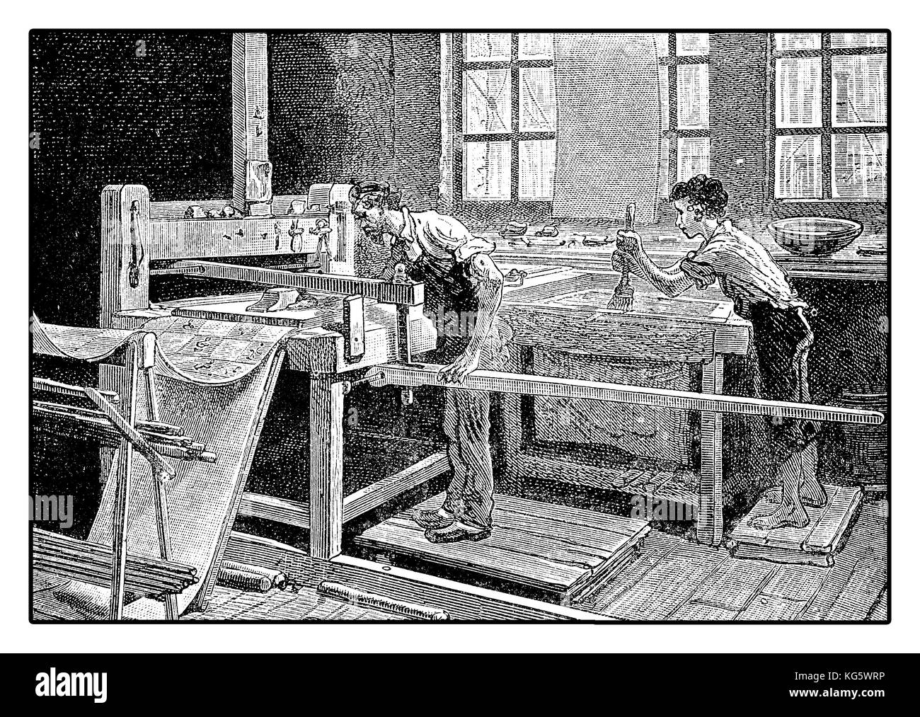 Printing tablecloth by hand, XIX century workshop - Stock Image