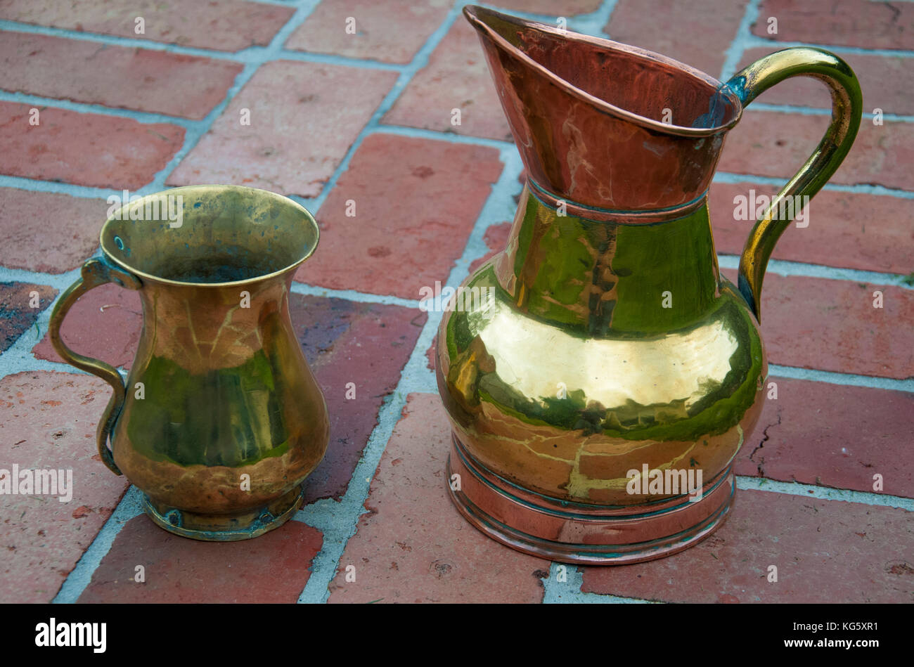 Antique brass jugs of varying provenance - Stock Image