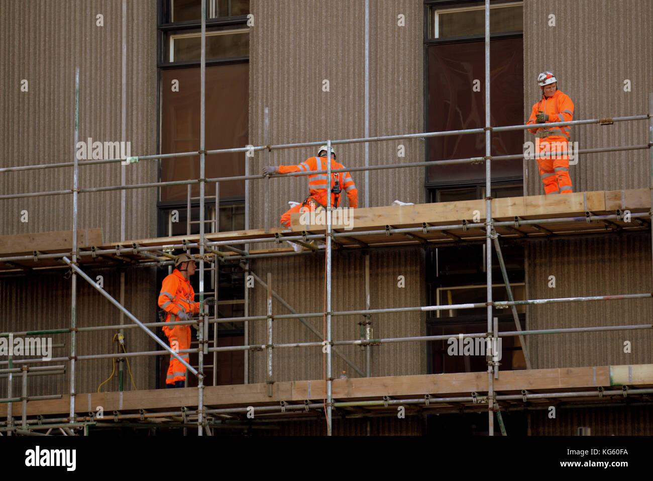 queen street station glasgow renovation scaffolding scaffolders workers hard hats - Stock Image