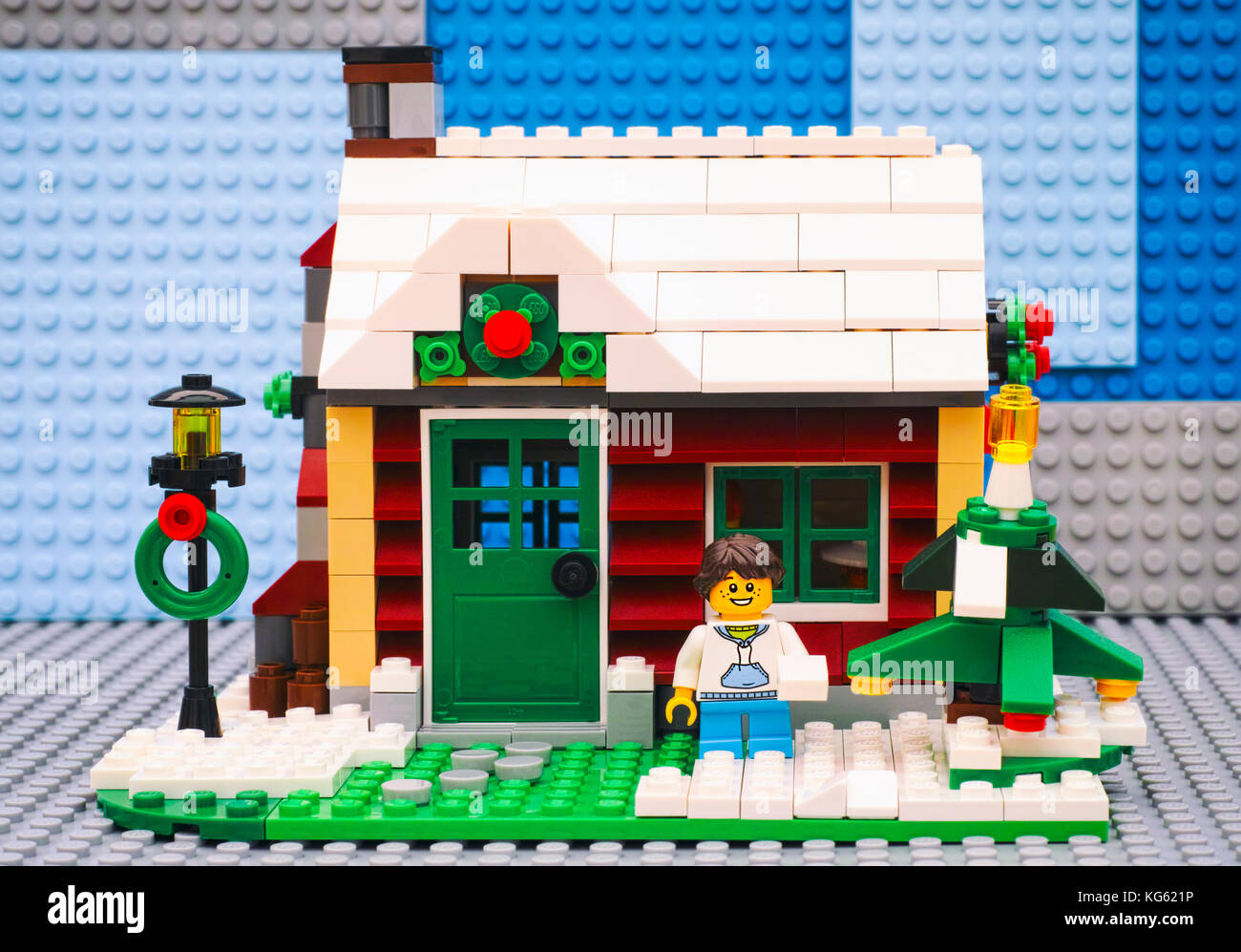 Tambov, Russian Federation - July 06, 2016 Lego girl with snowball near Christmas tree opposite her house. Studio - Stock Image