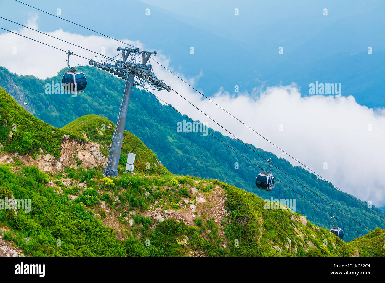 Cableway on the background of ridges and mountainsides in Rosa Khutor, Russia - Stock Image