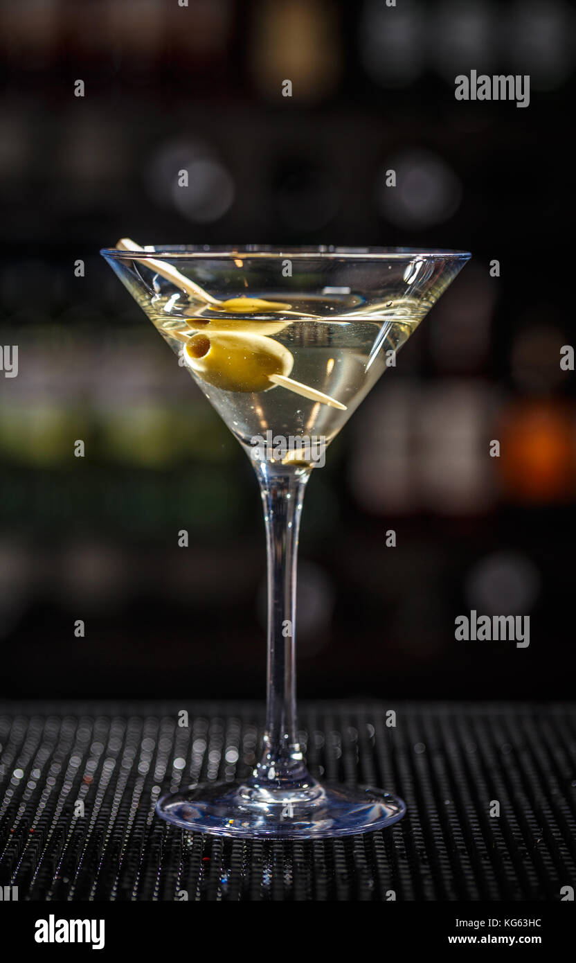 Close up of martini cocktail with green olives - Stock Image