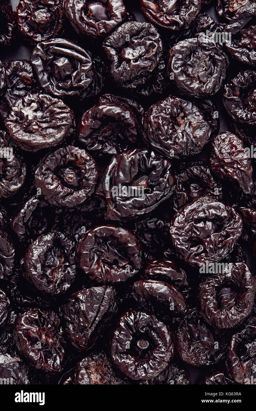 Dried plums or prunes fruit background texture - Stock Image