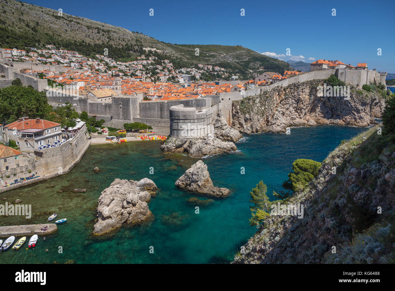 Old Town of Dubrovnik sitting behind its strong defensive walls and Mt Srd rising in the background.  Image taken - Stock Image