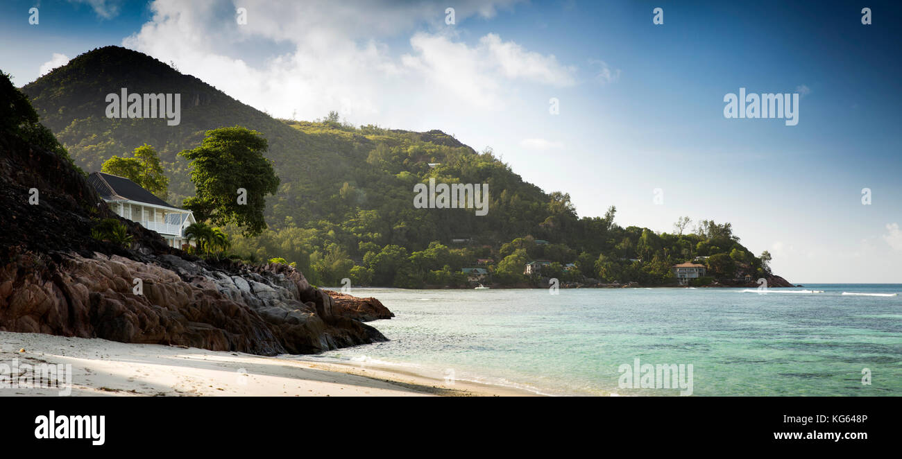 The Seychelles, Praslin, Petit Anse, seafront property on Grand Anse headland, panoramic - Stock Image
