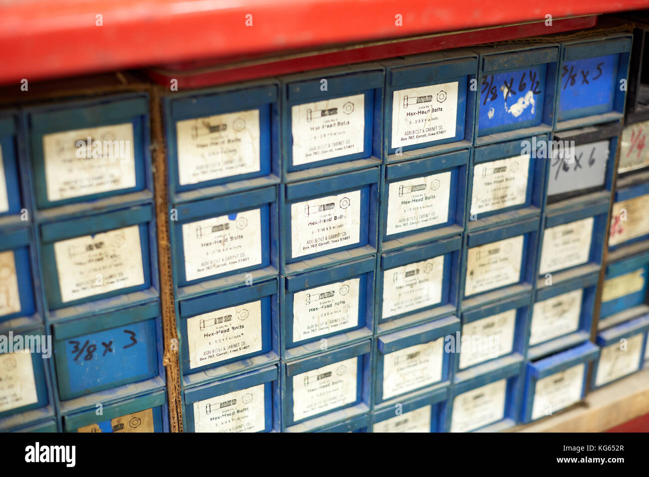 Storage Cabinet With Lots Of Small Drawers With Text Labels In An