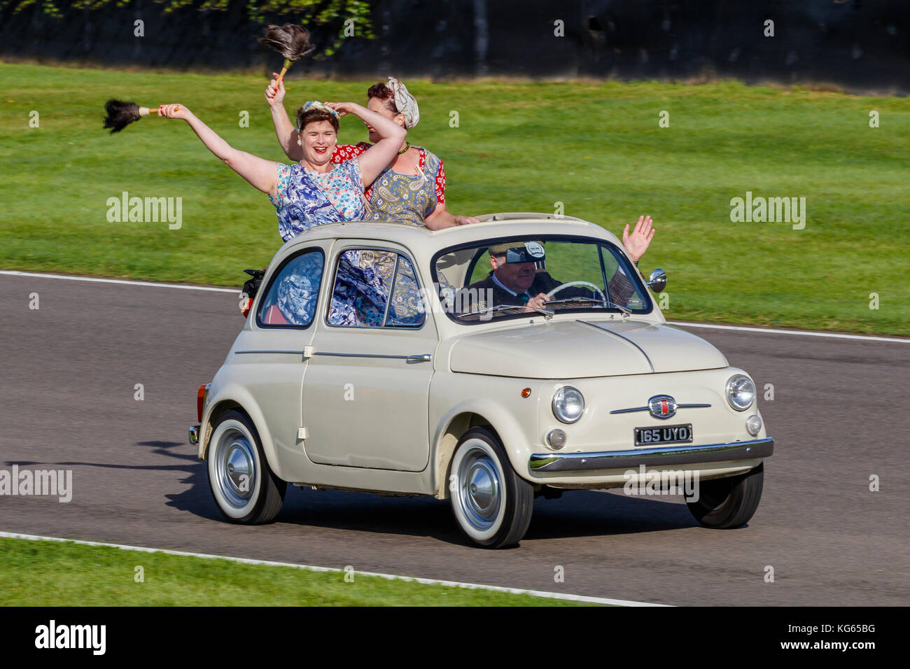 The classic Fiat 500 is celebrated in an Italian cavalcade at the 2017 Goodwood Revival, Sussex, UK. - Stock Image