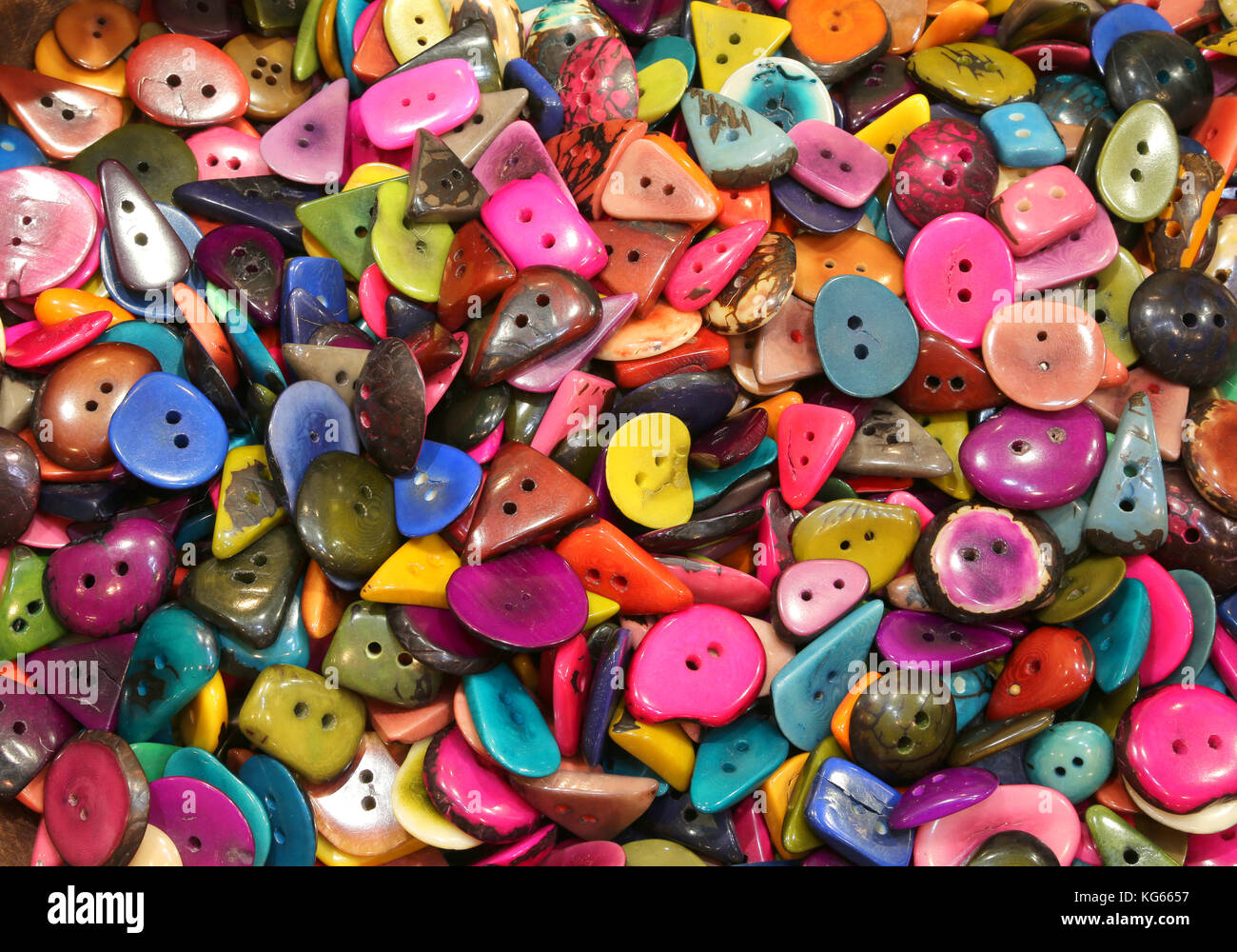 background of colored buttons made with the seeds of the tropical