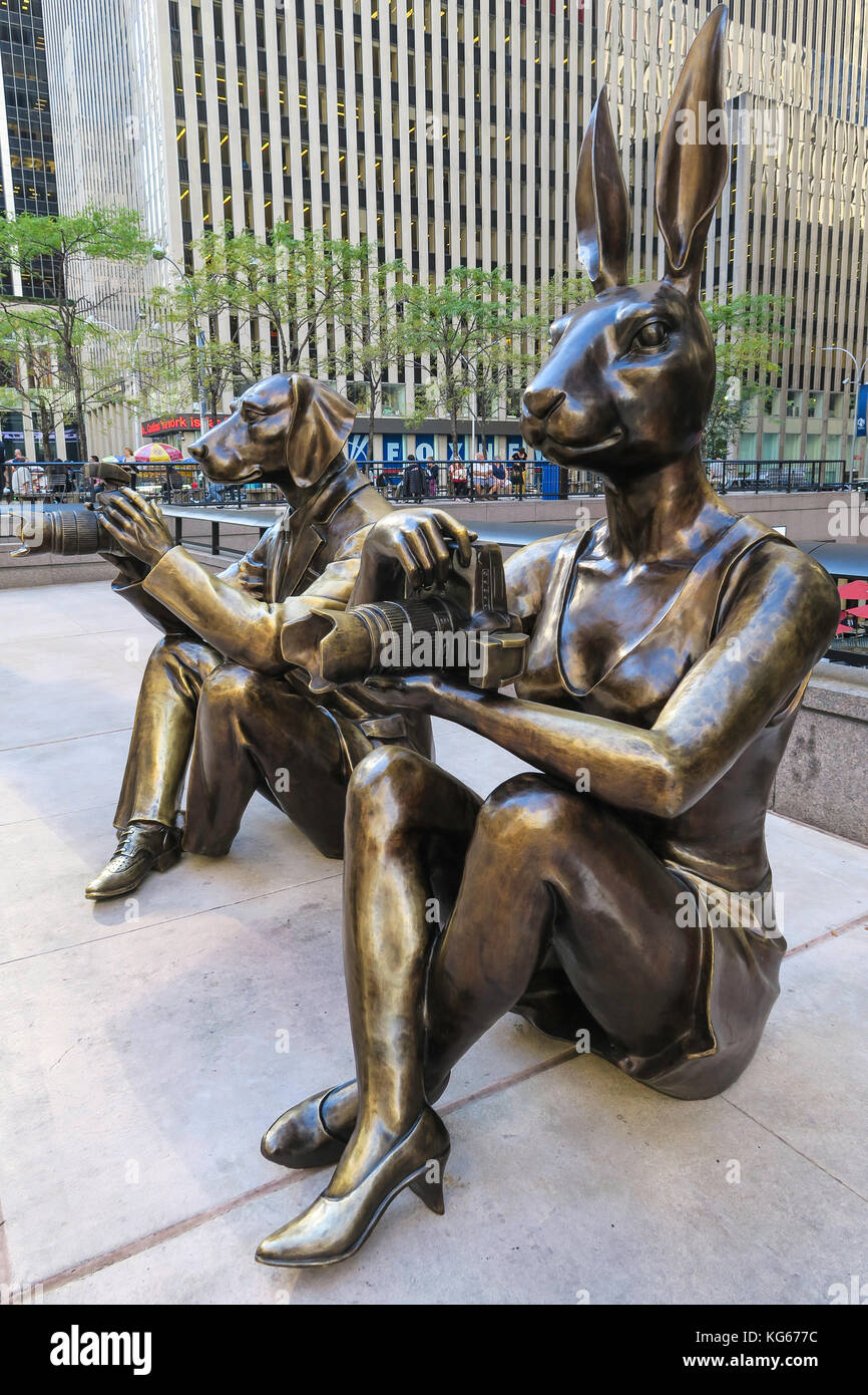 Paparazzi Dogman and Paparazzi Rabbitgirl Sculptures at 1221 Avenue of the Americas, NYC, USA - Stock Image