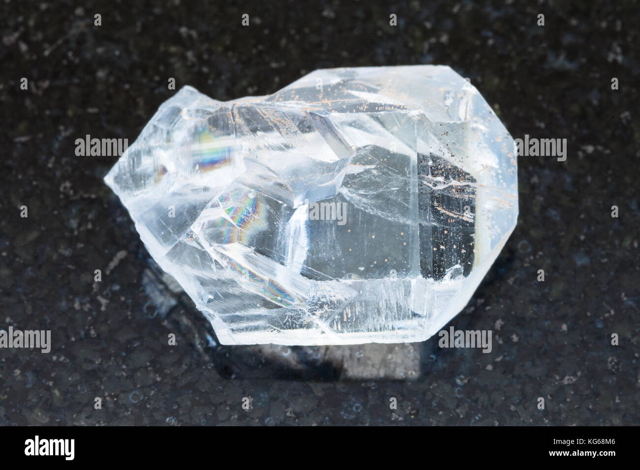 macro shooting of natural mineral rock specimen - raw crystal of celestine stone on dark granite background from - Stock Image