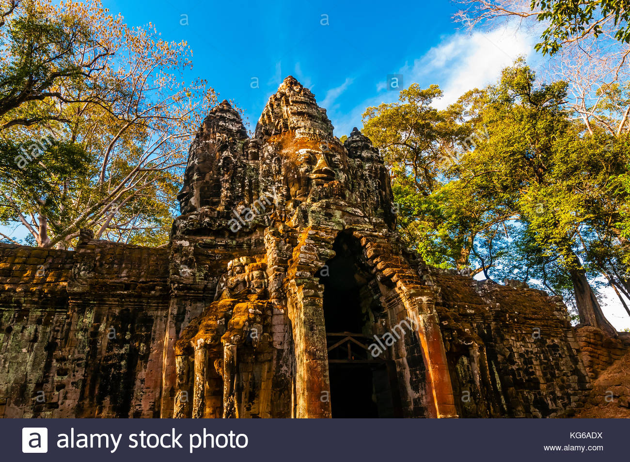 One of the gates adorned with stone faces, Angkor Tom (Angkor Wat complex), Cambodia. - Stock Image