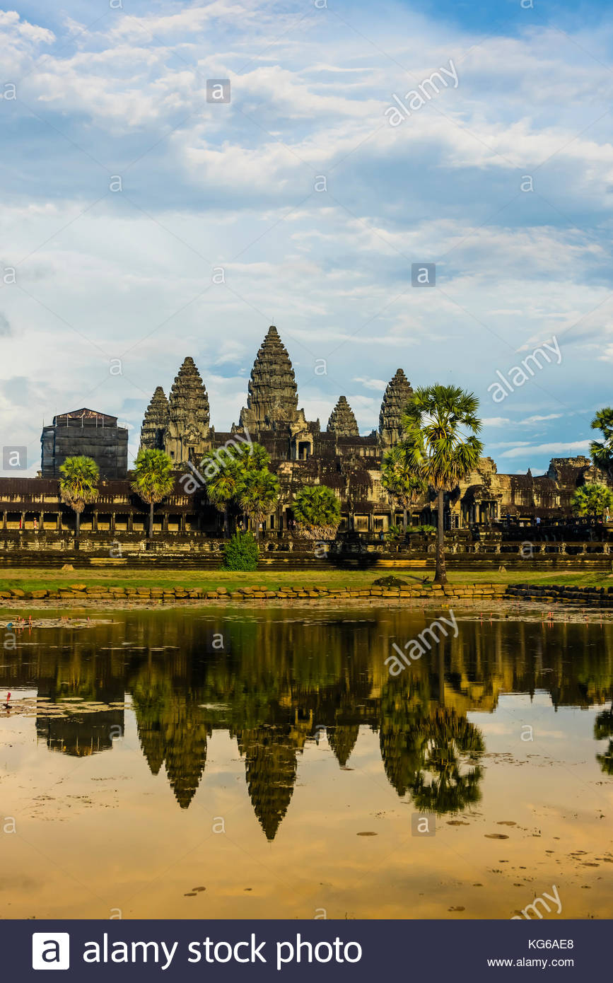 View of Angkor Wat with pond. It is the largest religious monument in the world. It's name means City which - Stock Image