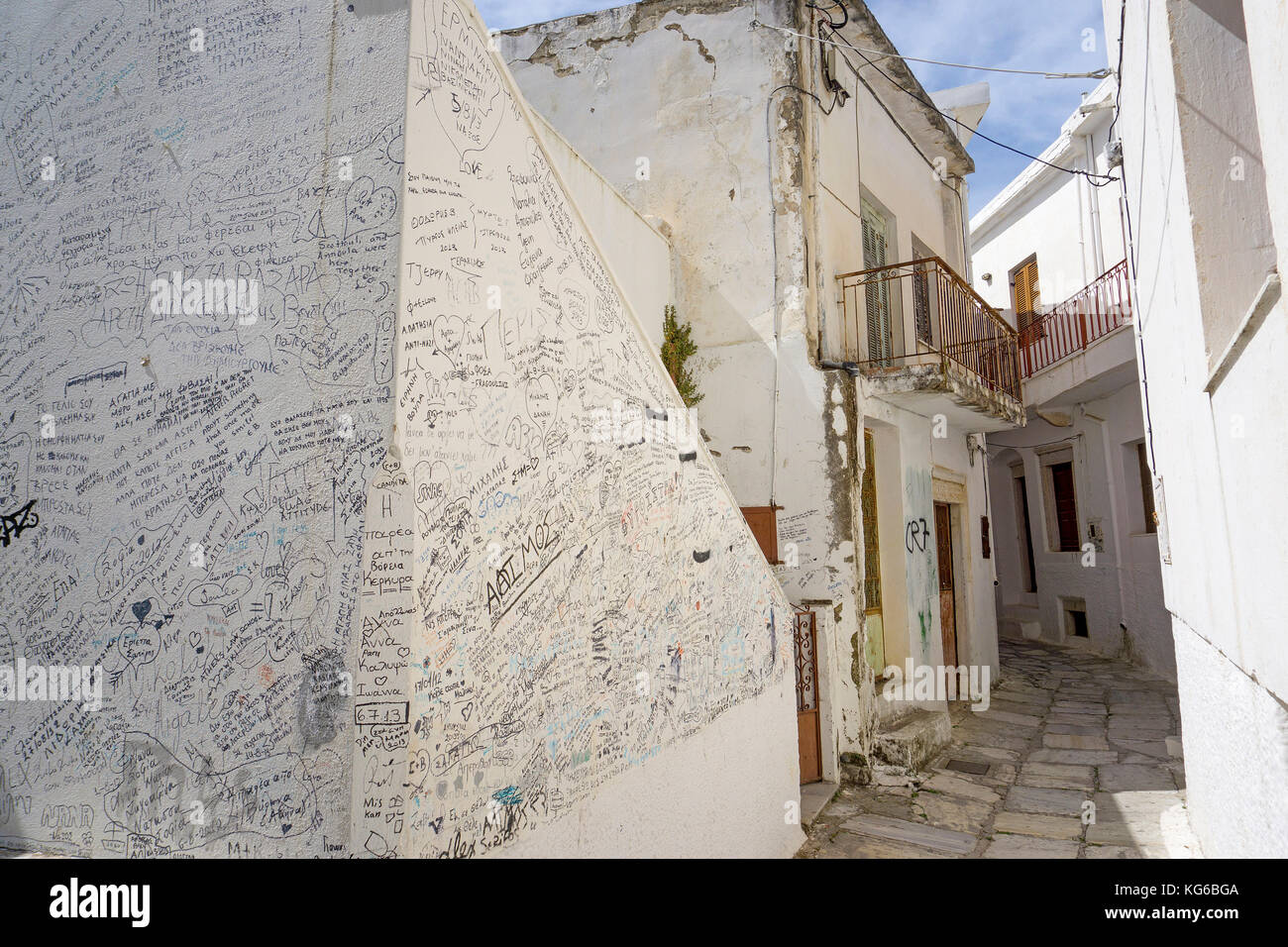 Wall covered with writings and paintings, mountain village Apiranthos, Naxos island, Cyclades, Aegean, Greece - Stock Image