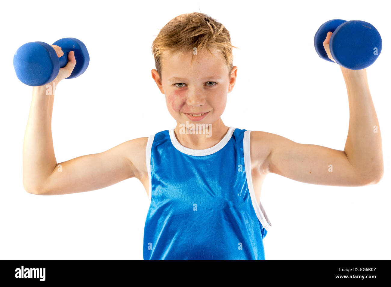 Pre-teen boy lifting weights isolated on a white background - Stock Image