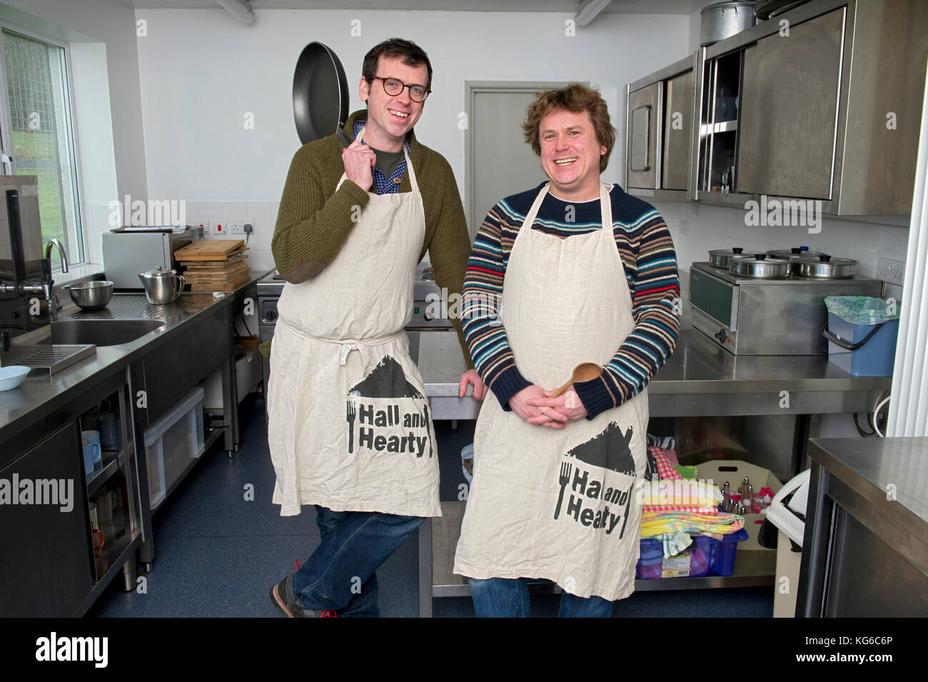 Chefs Tim Maddams (scarf & glasses)) and business partner Robin Rea outside Stockland village hall. - Stock Image