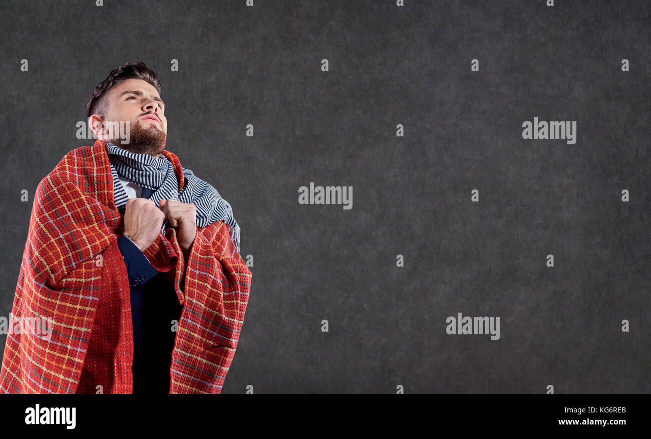 A sick man in a blanket.  Stock Photo