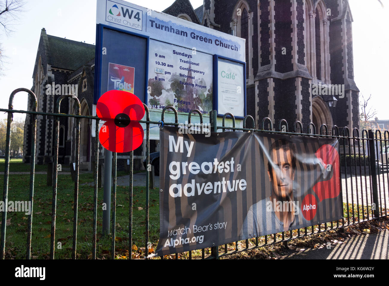 A giant poppy as part of a Remembrance memorial in Chiswick, west London, UK. - Stock Image