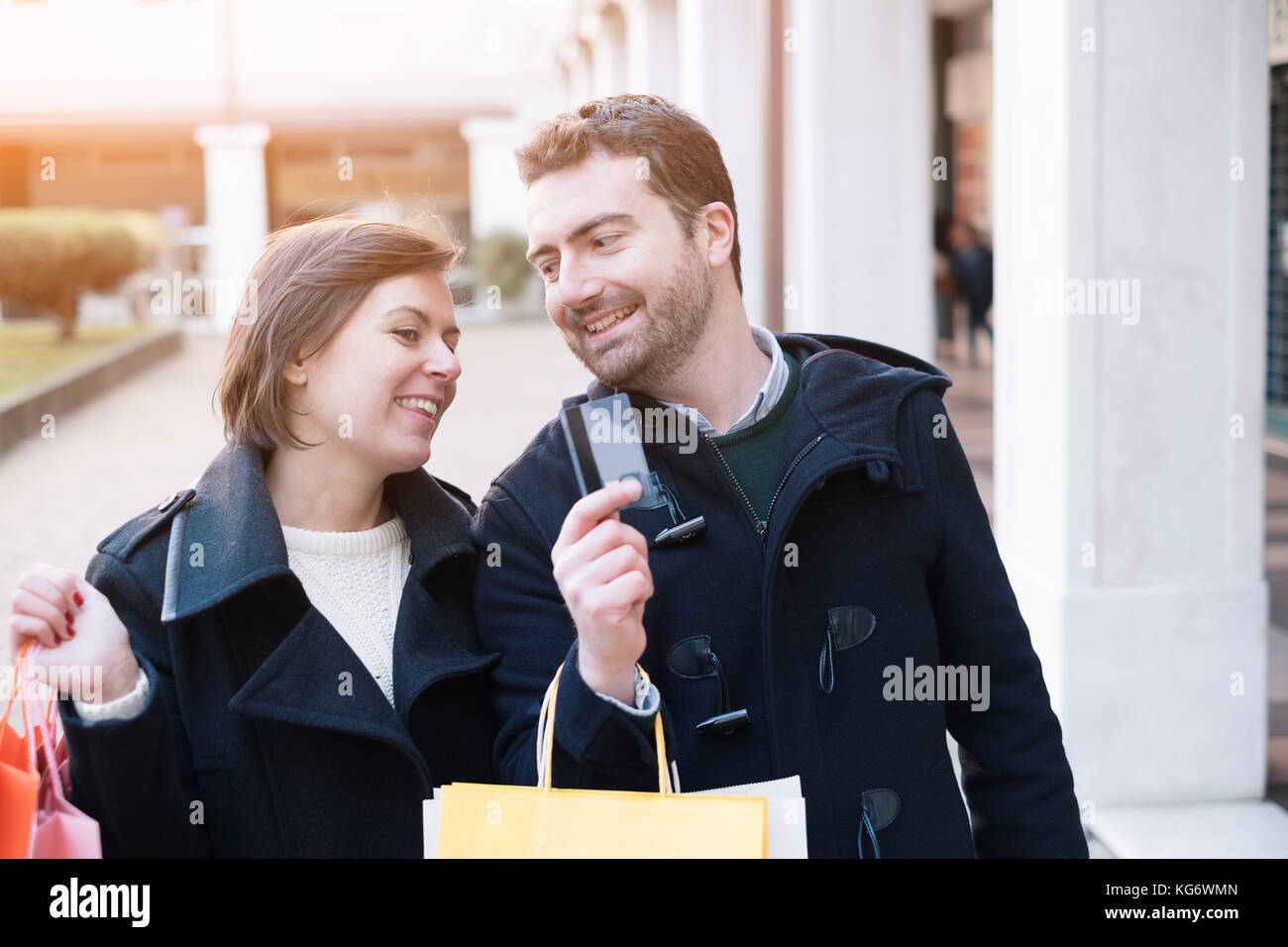 Man holding a credit card ready for the shopping time with his girlfriend - Stock Image