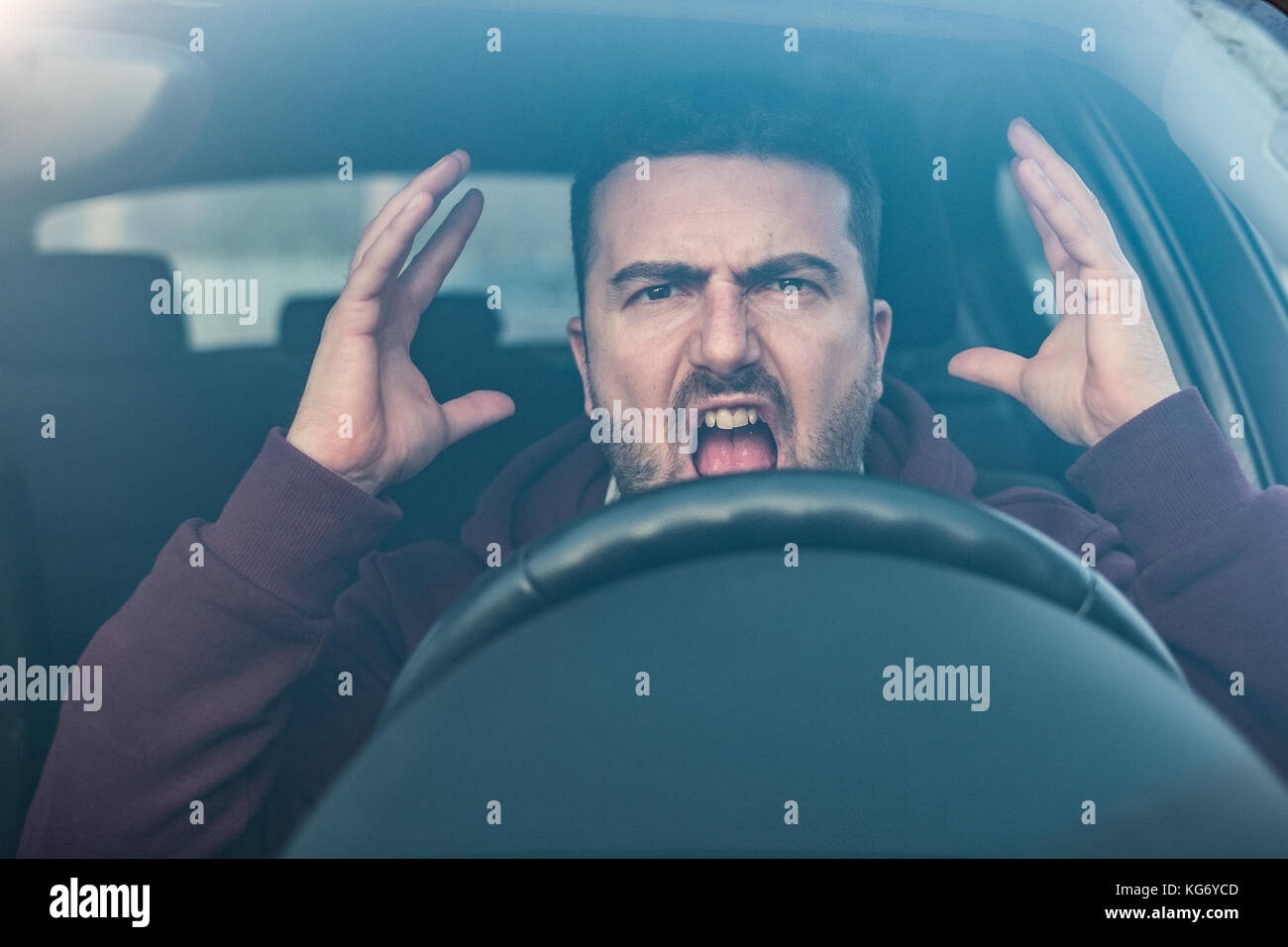 Rude man driving his car and arguing a lot - Stock Image