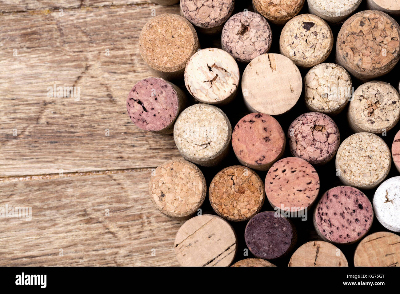 Stacked cork background on wuuden table - Stock Image