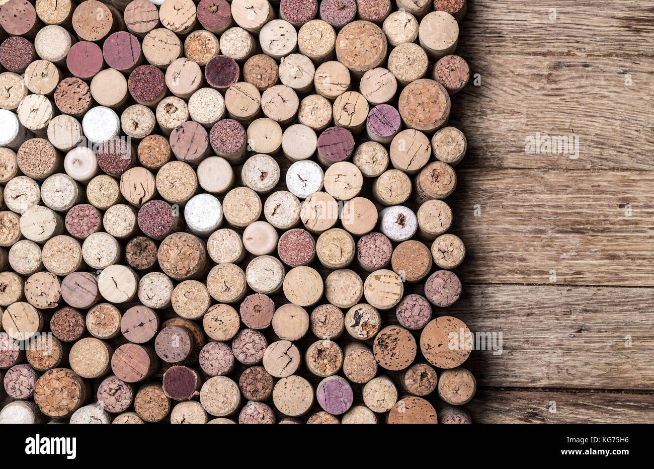 Wine corks on rustic wooden table background - Stock Image