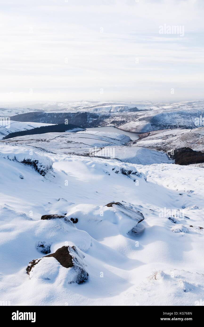 Snow covered countryside in winter with Kinder Reservoir viewed from Kinder Scout, Derbyshire, UK - Stock Image