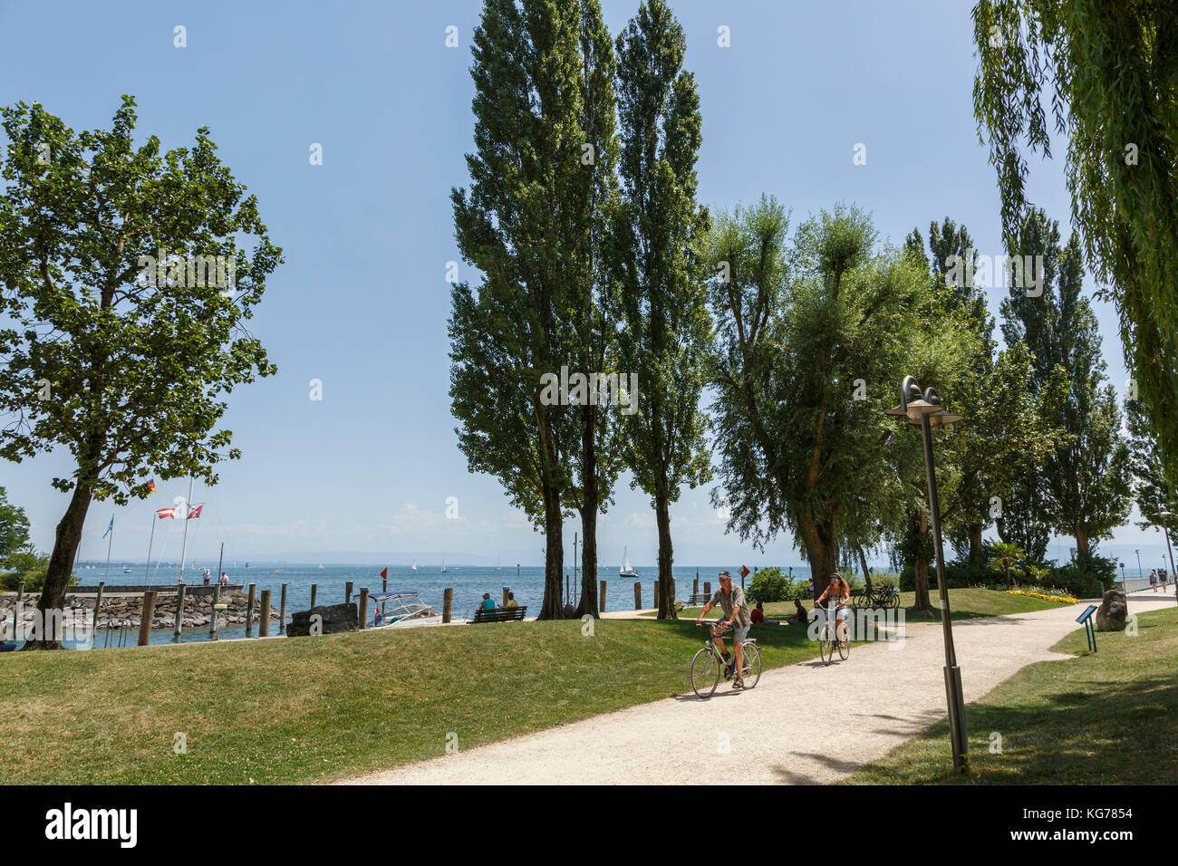Cycling beside the lake at Immenstaad am Bodensee, Baden-Württemberg, Germany Stock Photo
