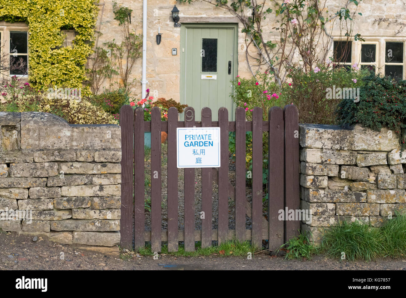 Bibury tourism - 'Private Garden' sign on garden gate written in English and Japanese - Bibury, Gloucestershire, - Stock Image