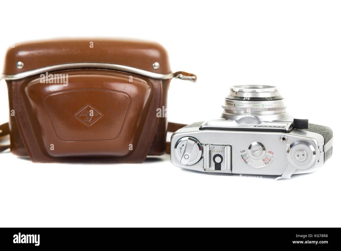Vintage Agfa analogue camera and leather case isolated on white background - Stock Image